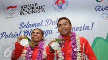 Raih Medali Perak, Dua Atlet Angkat Besi Tiba di Bandara Soetta