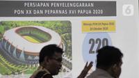 Layar monitor menampilkan Persiapan Penyelenggaraan PON XX dan Peparnas XVI Papua 2020 saat  rapat koordinasi tingkat meteri di Kantor Kemenkom PMK, Jakarta, Kamis (5/2/2020). Pelaksanaan PON tentu menjadi event bergengsi sekaligus membanggakan bagi Papua. (Liputan6.com/Faizal Fanani)