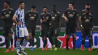 Manchester United meraih kemenangan 4-0 atas Real Sociedad pada laga leg pertama 32 besar Liga Europa di Allianz Stadium, Jumat (19/2/2021) dini hari WIB. (AFP/Marco Bertorello)