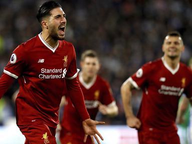 Ekspresi pemain Liverpool, Emre Can saat melakukan selebrasi usai membobol gawang Huddersfield Town pada lanjutan Premier League di John Smith's Stadium, Huddersfield, (30/1/2018). Liverpool menang 3-0. (Martin Rickett/PA via AP)