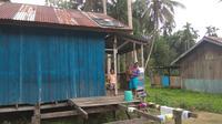 Rumah warga di Kampung Kriku, Kabupaten Keerom. (Liputan6.com/Katharina Janur)