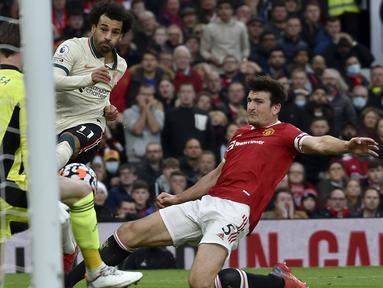 Seluruh pemain Manchester United yang tampil saat kalah 0-5 dari Liverpool, Minggu (24/10/2021) medapatkan rapor merah atas penampilannya. Tidak ada pemain yang mendapatkan minimal poin 6. Dari 14 pemain yang tampil, 7 di antaranya bahkan mendapat poin di bawah 5. (AP/Rui Vieira)