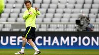 Lionel Messi saat latihan terakhir Barcelona jelang lawan Bayern Muenchen (Reuters / Michaela Rehle)