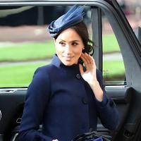 Meghan Markle saat menghadiri pernikahan Putri Eugenie (Foto: Gareth Fuller / POOL / AFP)