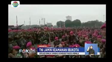 Ribuan personel TNI menggelar apel pasca-pemilu di Monas, Jakarta. Apel menandakan situasi kondusif pemilu.