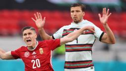 Ruben Dias yang sering disebut sebagai penerus Ronaldo, kurang bisa tampil maksimal, padahal ia selalu dimainkan Portugal dari menit awal. Penampilannya yang dinanti-nanti harus kandas usai Portugal tumbang 1-0 dari Belgia di babak 16 besar. (Foto: AFP/Pool/Alex Pantling)