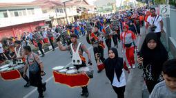 Suasana kegiatan Millenial Road Safety Festival Gorontalo, Minggu (10/2). Sejumlah kegiatan digelar di acara ini seperti panggung hiburan, jalan sehat yang diikuti SKPD, Sekolah, Mahasiswa Hingga TNI dan Polri. (Liputan6.com/Rahmad Arfandi Ibrahim)