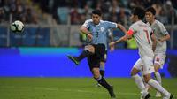 Timnas Uruguay menghadapi Jepang pada laga kedua Grup C Copa America 2019, di Arena do Gremio, Jumat (21/6/2019) pagi WIB. (AFP/Carl De Souza)