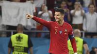 Pemain Portugal Cristiano Ronaldo berselebrasi usai mencetak gol ke gawang Prancis pada laga grup F Euro 2020 di Puskas Arena, Budapest, Kamis, 24 Juni 2021. (Franck Fife, Pool photo via AP)