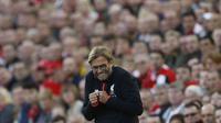 Ekspresi bahagia Jurgen Klopp menyaksikan kemenangan 4-1 Liverpool atas Leicester City di Anfield, Minggu (11/9/2016) dinihari WIB. (Reuters)