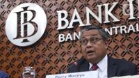 Gubernur Bank Indonesia Perry Warjiyo menyampaikan hasil Rapat Dewan Gubernur (RGD) Bank Indonesia di Jakarta, Kamis (19/12/2019). RDG tersebut, BI memutuskan untuk tetap mempertahankan suku bunga acuan 7 Days Reverse Repo Rate (7DRRR) sebesar 5 persen. (Liputan6.com/Angga Yuniar)