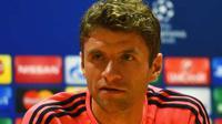 TERTEKAN - Thomas Muller menyebut Arsenal berada dalam tekanan besar jelang partai melawan Bayern Munchen. (Standard)