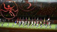 Meski sebagian besar atlet telah kembali ke negara masing-masing, beberapa atlet yang masih berada di Singapura turut hadir dalam penutupan SEA Games 2015. (AFP PHOTO/ROSLAN RAHMAN)