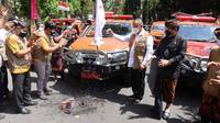 Kepala BNPB Ganip Warsito meluncurkan gerakan mobil masker ke seluruh wilayah kabupaten dan kota di Provinsi Bali. (Foto: Humas BNPB)