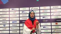 Atlet taekwondo Indonesia, Defia Rosmaniar, meraih medali emas di Asian Games 2018 (Liputan6.com / Ahmad Fawwaz Usman)