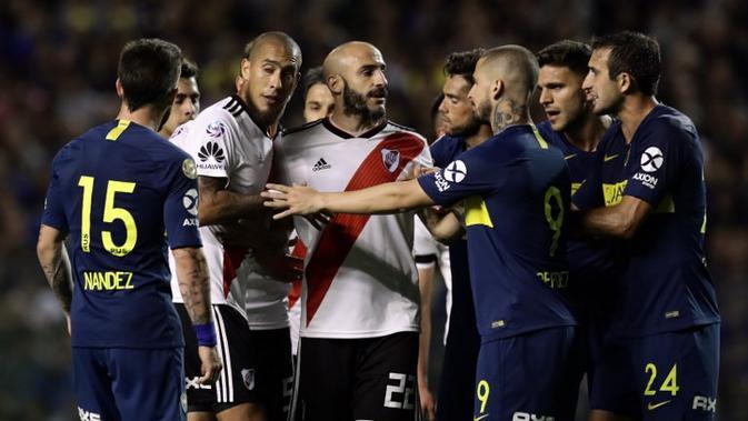 Laga bertajuk Super Claciso yang mempertemukan antara Boca Juniors vs River Plate menjadi salah satu pertandingan rivalitas yang panas di dunia sepak bola. (AFP/Alejandro Pagni)