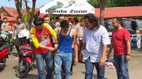 Slamet saat diamankan petugas kepolisian di Mapolresta Tanjungpinang (Foto: Adi/Batamnews)