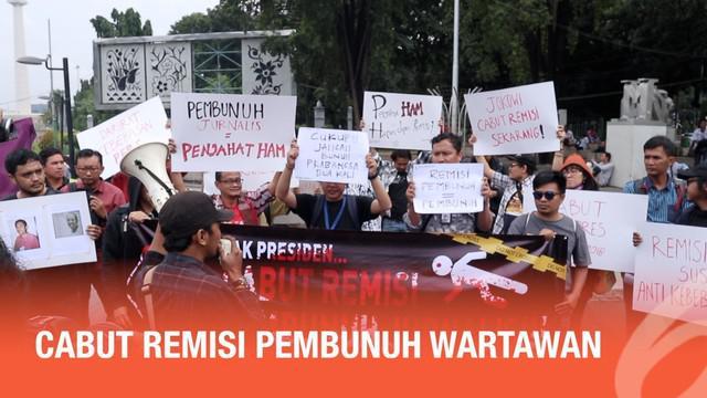 Aliansi Jurnalis Independen dan LBH Pers, menggelar aksi demo di depan Istana Negara. Mereka menuntut Presiden Jokowi mencabut remisi I Nyoman Susrana, yang membunuh jurnalis Radar Bali.