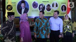 Ketua MPR Bambang Soesatyo atau Bamsoet (tengah) menghadiri acara diskusi publik yang diselenggarakan Posbakum Golkar di Jakarta, Selasa (12/11/2019). Diskusi tersebut membahas mengangkat tema 'Golkar Mencari Nakhoda Baru'. (Liputan6.co/Johan Tallo)