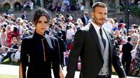 Legenda Timnas Inggris, David Beckham, bersama istrinya Victoria Beckham saat menghadiri upacara pernikahan Pangeran Harry dan Meghan Markle di St George Chapel di kastil Windsor, (19/5/2018). (Photo by Chris Radburn / POOL / AFP)