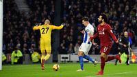 Mohamed Salah berhasil mencetak gol tunggal kemenangan Liverpool atas Brighton and Hove Albion pada laga pekan ke-22 Premier League, di The American Express Community Stadium, Sabtu (12/1/2019). (AFP/Glyn Kirk)