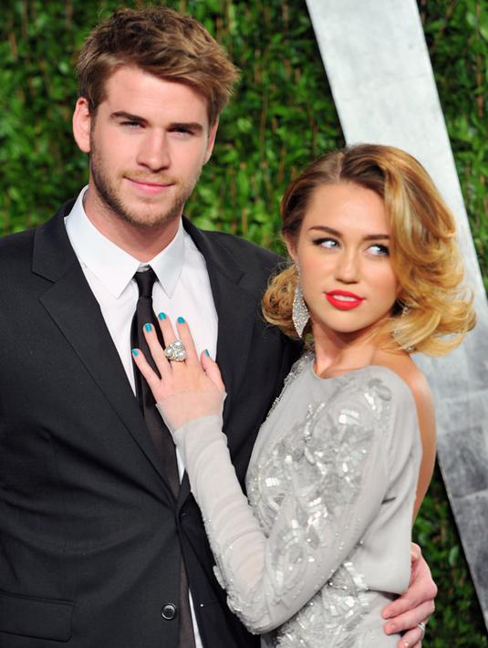 Kedua pasangan selebriti Miley Cyrus dan Liam Hemsworth memang sering diterpa gosip dan rumor mereka akan pisah dan batal menikah. (AFP/Bintang.com)