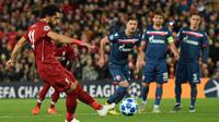 Liverpool bersua Crvena Zvezda pada pertandingan ketiga Grup C Liga Champions, di Stadion Anfield, Rabu (24/10/2018) malam waktu setempat. (AFP/Oli Scarff)
