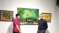 Anfield Wibowo bersama Aktor Indonesia M.Farhan saat Pameran Warna Warni Dunia (dok.Liputan6.com/Devita)