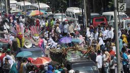 Pawai ondel-ondel meramaikan Musabaqah Tilawatil Quran (MTQ) ke-9 tingkat Kota Tangerang Selatan (Tangsel), Banten, Senin (17/9). MTQ dilangsungkan pada tanggal 17 hingga 20 September 2018. (Merdeka.com/Arie Basuki)