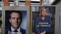 Emmanuel Macron dan Marine Le Pen (AP)