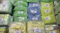 Barang bukti narkoba jenis sabu dan ekstasi yang disita oleh Badan Narkotika Nasional (BNN) dalam upaya penyelundupan di wilayah Dumai, Riau, Jumat (17/5/2019). Petugas BNN menembak dua pelaku penyelundupan lantaran mencoba melarikan diri saat penangkapan. (Liputan6.com/HO/Tim BNN)
