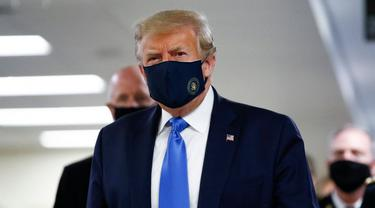 Presiden AS Donald Trump memakai masker di depan publik untuk pertama kalinya (AP PHOTO / Patrick Semansky)