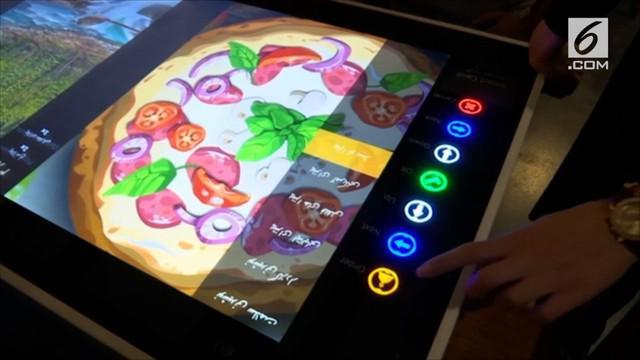 Restoran Pizza di Iran mengusung konsep masa depan. Pelanggan tidak perlu memanggil pelayan untuk memesan pizza.
