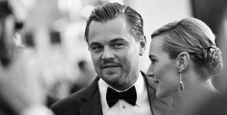 Leonardo DiCaprio dan Kate Winslet memang memiliki kedekatan sejak lama. Terlebih saat keduanya bermain dalam satu judul film yang sama, yakni Titanic pada tahun 1997 silam. (AFP/Charley Gallay)