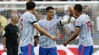 Cristiano Ronaldo merayakan gol penyeimbang kedudukan saat Manchester United bertandang ke markas West Ham United, Minggu (19/9/2021). The Red Devils menang 2-1 berkat tambahan gol dari Jesse Lingard. (IAN KINGTON / AFP)