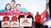 Bank BNI memberikan bonus apresiasi  berupa reksadana kepada Greysia Polii/Apriyani Rahayu dan Anthony Sinisuka Ginting, yang meraih medali di Olimpiade Tokyo 2020.  (dok. BNI)