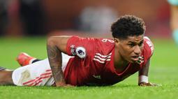Marcus Rashford - Pemain asal Inggris ini masih belum bisa tampil lantaran mengalami cedera bahu sejak November 2020. Rashford yang dipersiapkan untuk duet dengan Cristiano Ronaldo itu diperkirakan baru bisa bermain pada pekan ke-12 di Liga Inggris. (Foto: AFP/Michael Regan)
