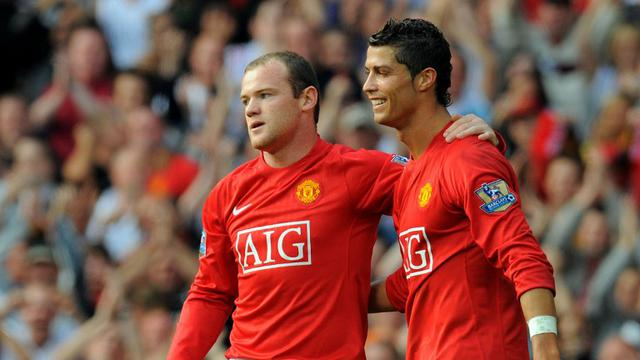 Wayne Rooney dan Cristiano Ronaldo (AFP PHOTO/ANDREW YATES)