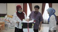 Berkas yang diberikan Tim Prabowo-Hatta telah disahkan oleh Mahkamah Konstitusi sebagai alat bukti, Jakarta, Senin (18/8/2014) (Liputan6.com/Herman Zakharia)