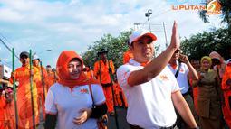 Walikota Tangerang Arief R Wismansyah bersama istri, Rabu (23/4/2014) (Liputan6.com/Faisal R Syam).