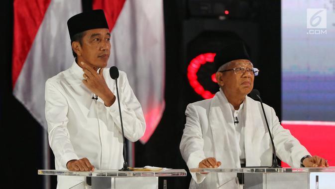 Capres nomor urut 01 Joko Widodo dan Cawapres Ma'ruf Amin beradu gagasan selama Debat Pilpres 2019 kelima di Jakarta, Sabtu (13/4). Debat kelima merupakan debat terakhir dalam masa kampanye dan mengambil tema Ekonomi, Kesejahteraan Sosial, Keuangan dan Investasi. (Liputan6.com/Johan Tallo)#source%3Dgooglier%2Ecom#https%3A%2F%2Fgooglier%2Ecom%2Fpage%2F2019_04_14%2F455724