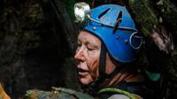 Penyelam asal Inggris, Robert Charles Harper, mengeksplorasi pintu masuk gua selama operasi penyelamatan di gua Tham Luang, Chiang Rai, Thailand pada 29 Juni. (Krit Phromsakla Na Sakolnakorn/AFP)
